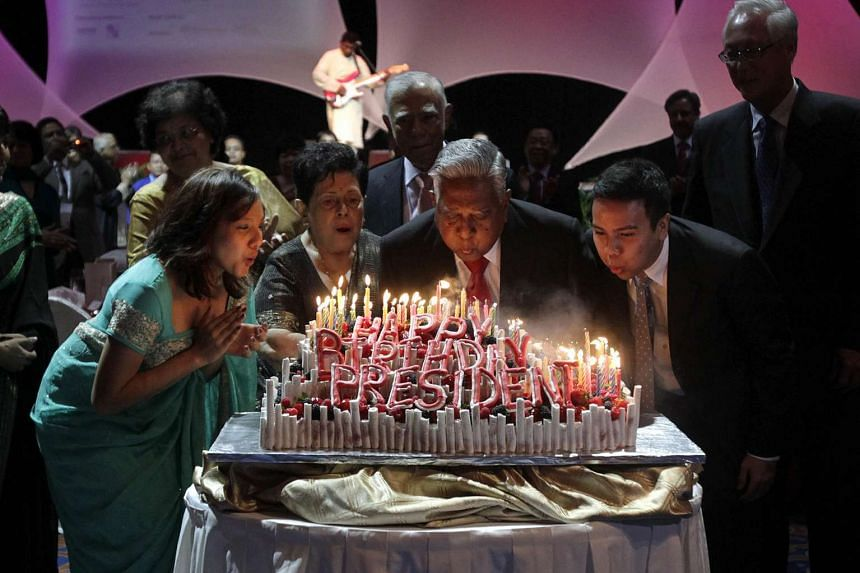 Belated celebration of President S R Nathan's 87th birthday in July 2011: (from left) his granddaughter Monisha Cheong, Mrs Nathan, Mr Nathan and grandson Kiron Cheong.