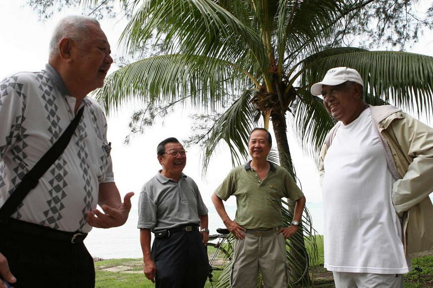 President S R Nathan chats with Mr Wee Hoon Leung, 78, an ex-national footballer, and his friends at East Coast Park.
