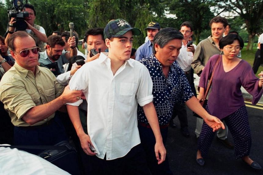 American teenager Michael Peter Fay , then 18, being led out of the Queenstown Remand Prison by his father George Fay (left) and his stepfather Marco Chan (right).
