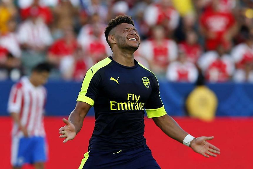 Arsenal's Alex Oxlade-Chamberlain reacts after missing a shot at a pre-season friendly between Chivas de Guadalajara and Arsenal in Los Angeles.