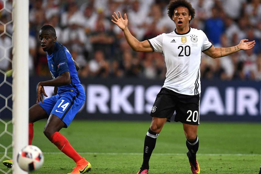 Leroy Sane (right) eyes the ball during the Euro 2016 semi-final football match between Germany and France in Marseille, on July 7, 2016.