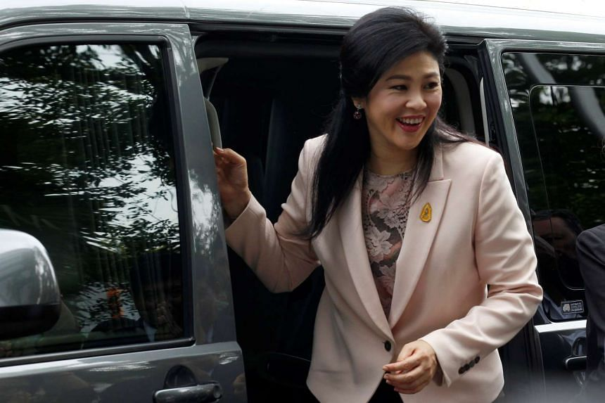 Yingluck Shinawatra arrives at the Supreme Court for a trial on criminal negligence looking into her role in a debt-ridden rice subsidy scheme in Bangkok, on May 18, 2016.