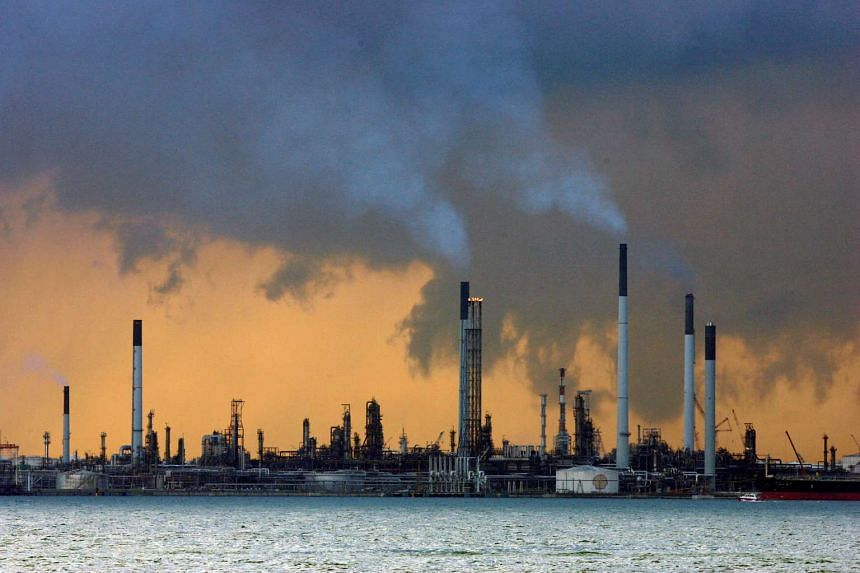 A view of an oil refinery off the coast of Singapore on March 14, 2008.