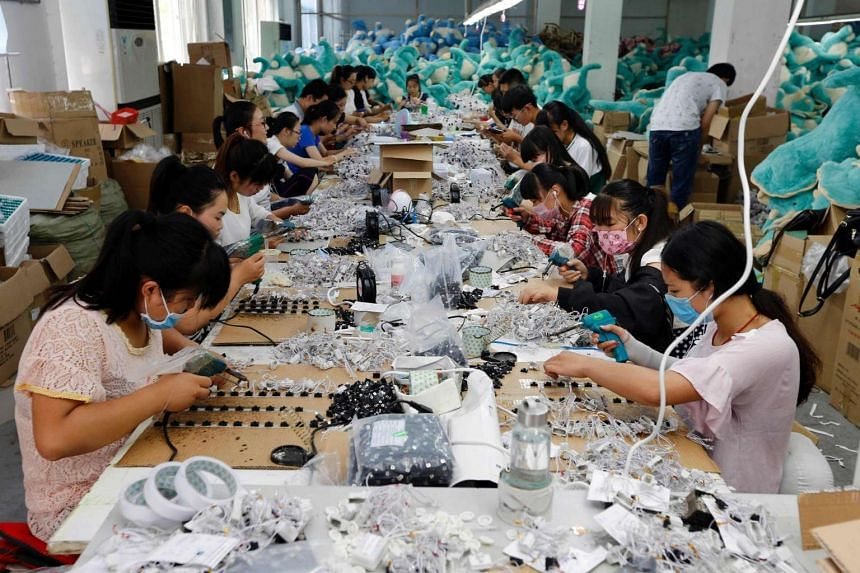 Workers making soft toys in a toy factory in Lianyuangang, in eastern China's Jiangsy province in July.