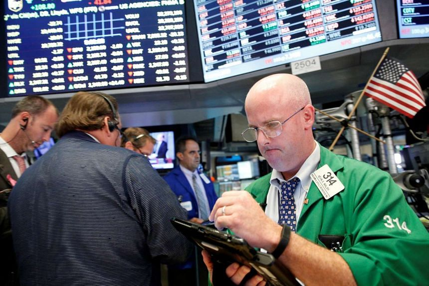 Traders work on the floor of the New York Stock Exchange on July 28, 2016.