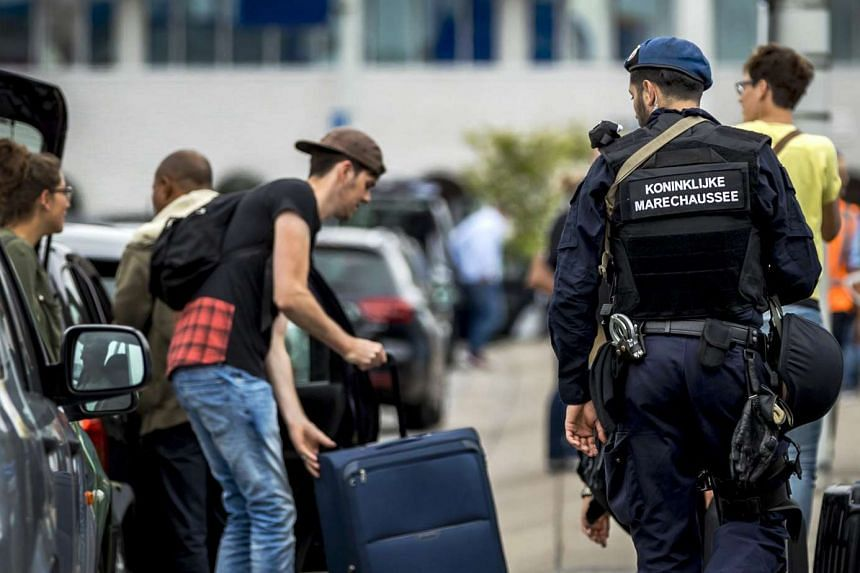 Dutch military police carry out extra patrols at Schiphol Airport in Amsterdam, on July 30, 2016.