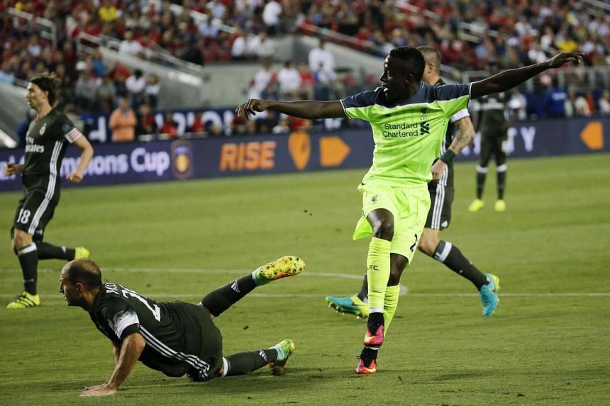 Liverpool FC's forward Divock Origi (right) follows through with a score past AC Milan's Gabriel Paletta (left) during the second half of the International Champions Cup at Levi's Stadium in Santa Clara, California, USA on July 30.