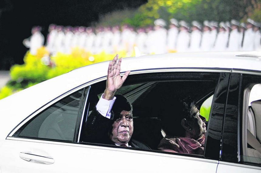 Singapore's outgoing president S R Nathan waving his final goodbye to the cheering crowd as he and his wife leave the Istana after the farewell parade on Sept 1, 2011.