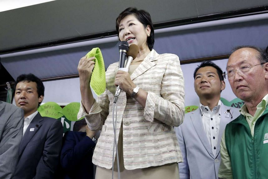 Yuriko Koike celebrates her victory in the Tokyo Gubernatorial Election at her election campaign office in Tokyo, Japan on July 31, 2016.