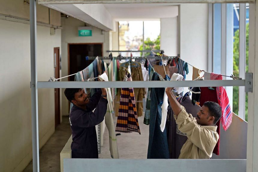 Workers hanging their laundry inside the ASL Shipyard dormitory along Pandan Road.