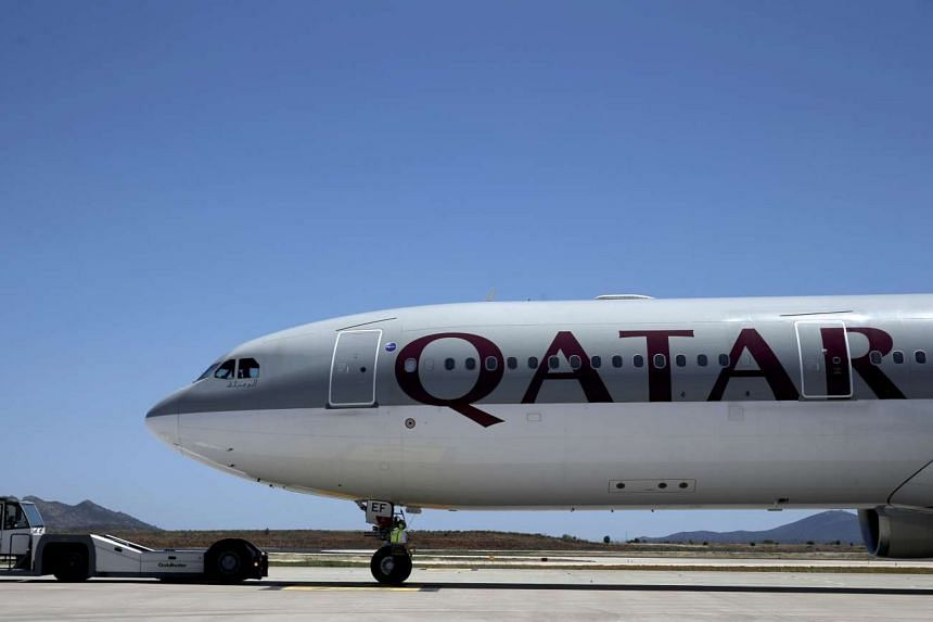 A Qatar Airways aircraft is seen at a runway of the Eleftherios Venizelos International Airport in Athens, Greece.