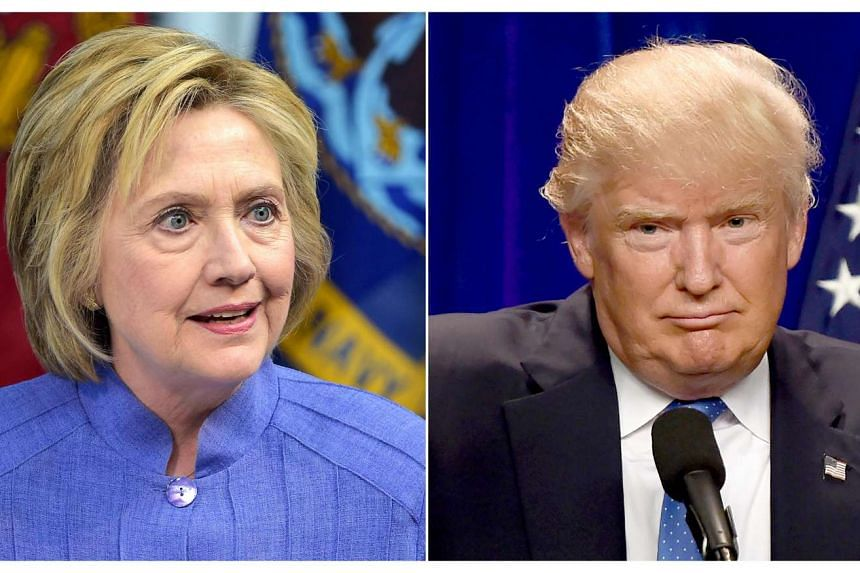 Hillary Clinton (left) now leads Donald Trump by seven points in the race for the White House, a poll released Monday (Aug 1) showed.