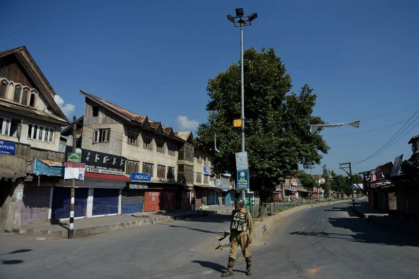 An Indian paramilitary trooper stands guard during a curfew in Srinagar on Aug 1, 2016.