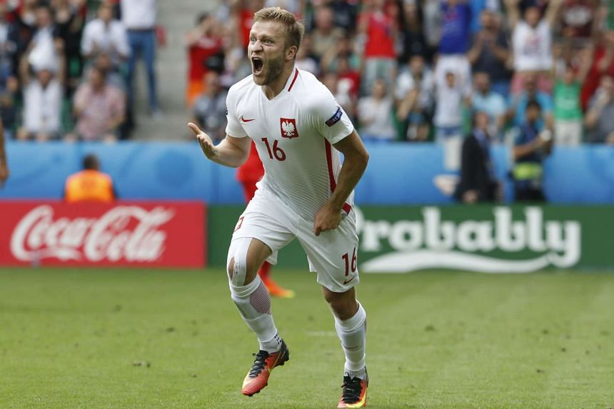Poland's Jakub Blaszczykowski celebrates after scoring their first goal at the Euro 2016 Round of 16 match between Switzerland and Poland, on June 25, 2016.