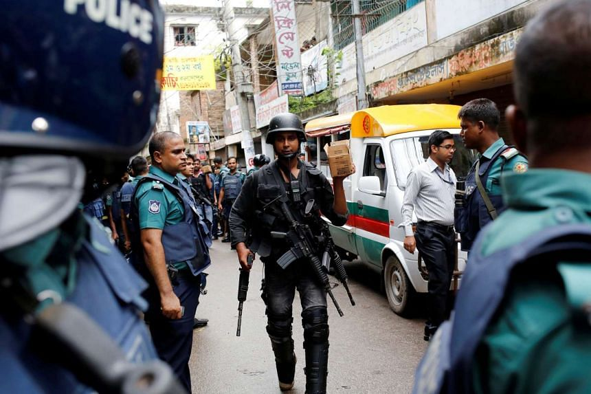 Security personnel leave the site after a police operation on militants, on the outskirts of Dhaka, on July 26, 2016.