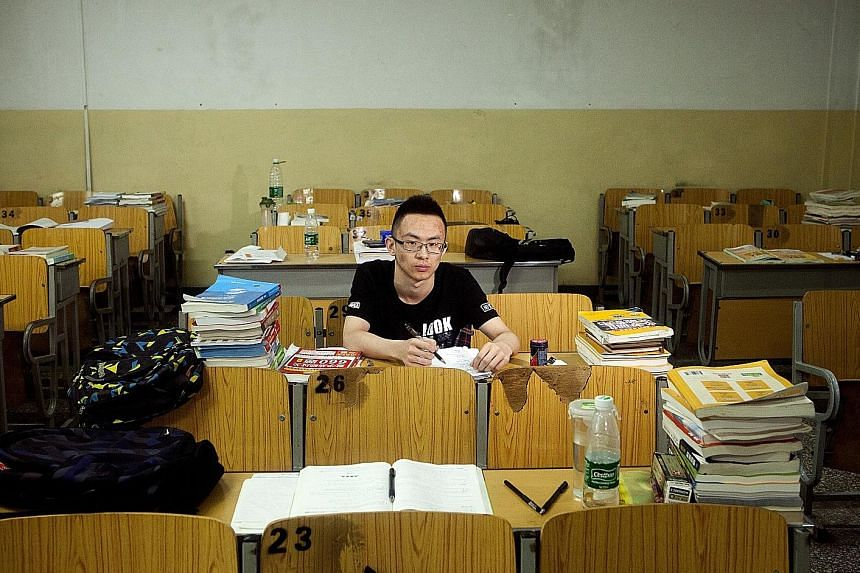 Communication engineering student Xian Guangnan, 21, at Beijing Information Science and Technology University. While the government has built hundreds of universities in recent years, many varsities are mired in bureaucracy and lax academic standards