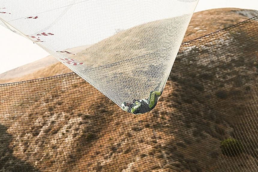 American skydiver Luke Aikins bouncing in a net that broke his fall after he jumped from an aeroplane flying at a height of more than 7,600m without a parachute or wing suit. His stunt in Simi Valley, California, last Saturday set a world record. SEE