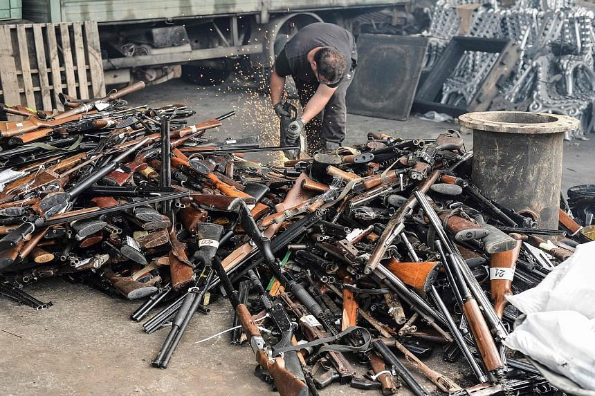Illegal weapons seized by the authorities being cut up into pieces before being destroyed at a foundry. Firearms are easy to obtain in Kosovo, where violence and extremism have been on the rise, often fuelled by Arab-linked networks and organisations