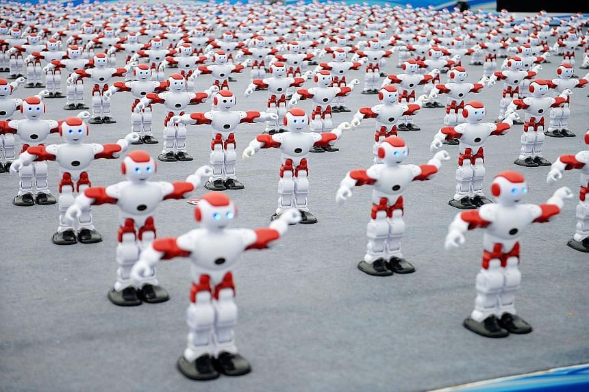 Over 1,000 smart robots dancing in unison at the International Beer Festival in Qingdao, in China's Shandong province, last Saturday. The robots set a new Guinness World Record by dancing together for more than one minute. The previous record was hel