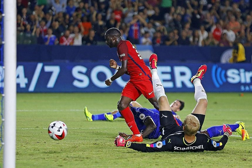 Paris Saint-Germain's Jonathan Ikone scoring the second goal against Leicester City in the International Champions Cup. The French league champions won the match 4-0.
