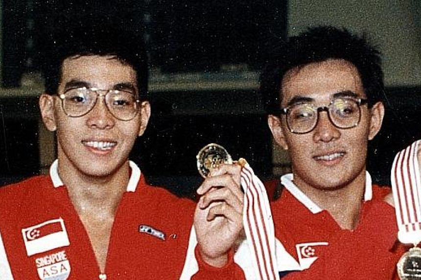 Oon Jin Teik and Oon Jin Gee (swimming – (right and left).