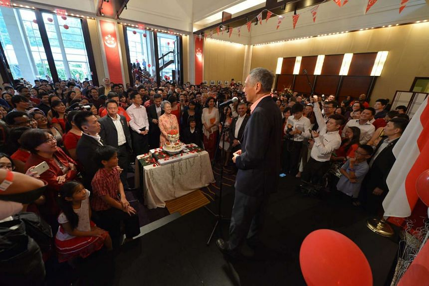 PM Lee addresses Singaporeans at the National Day celebrations in the Singapore embassy in Washington, DC, on July 31. Accompanying PM Lee are Members of Parliament and Cabinet ministers.