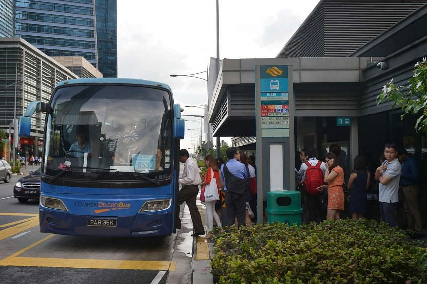 Commuters boarding a City Direct Service at the Downtown Station bus stop.