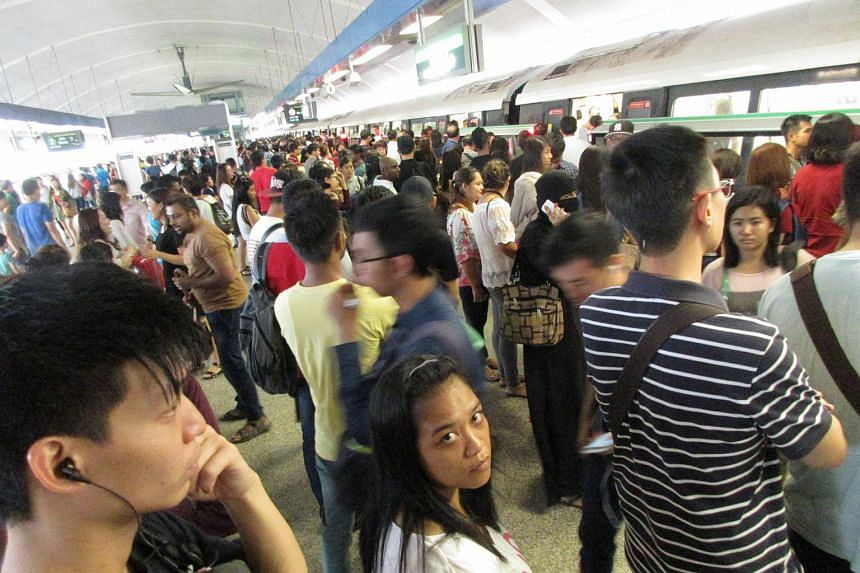 The crowd at Aljunied MRT station after they were told to alight from the train.