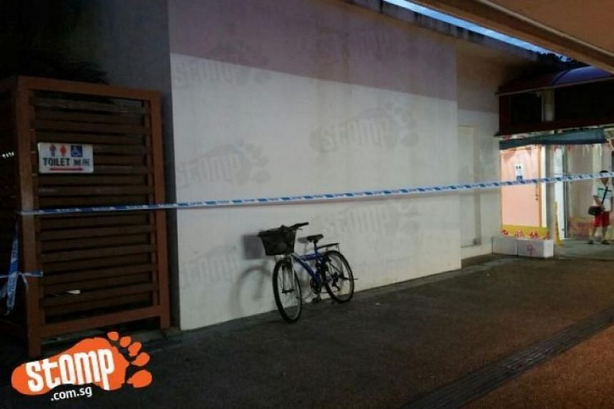 Police tape is seen outside the toilet at Haig Road Market and Food Centre, after a man was dead, on July 31, 2016.