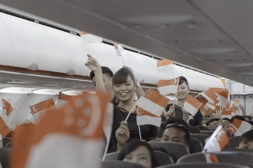 A scene from Jetstar's video of one of its Singlish flights.