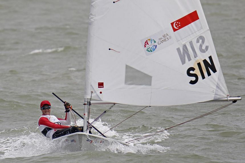 Singapore's sailor Bernie Chin Cheok Khoon in action as he wins the gold medal at the 28th SEA Games in the Male Youth Laser Radial (U19) event.