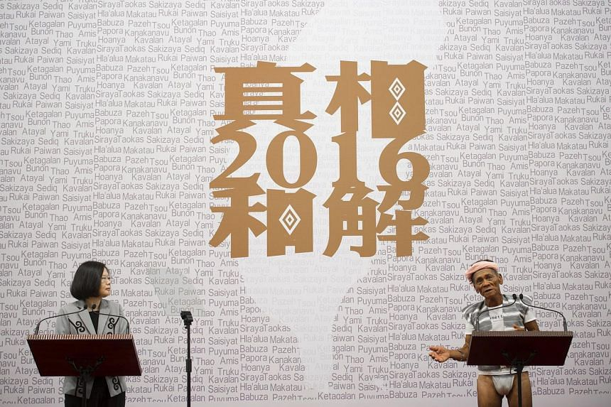 This handout photo taken and released by Taiwan's Presidential Office on August 1, 2016 shows Taiwan's President Tsai Ing-wen (L) listening as 80-year-old indigenous Yami leader Capen Nganaen (R) speaks during a ceremony at the Presidential Office bu