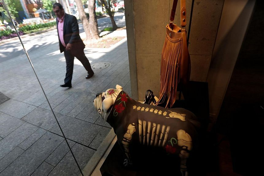 Products are displayed in the window of a Prison Art store at the upscale neighbourhood of Polanco, Mexico City, on June 14.