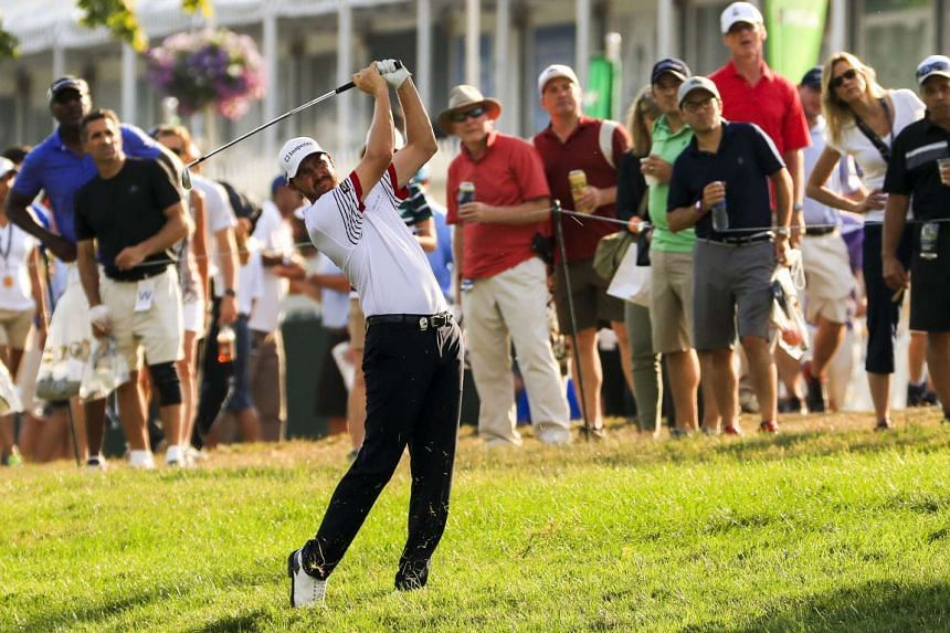 Jimmy Walker of the United States leads Jason Day in the PGA Championship at Baltrusrol.