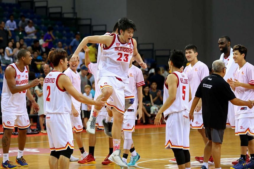 The Singapore Slingers celebrating after their win over Hi-Tech Bangkok City in their Asean Basketball League match on March 6, 2016.