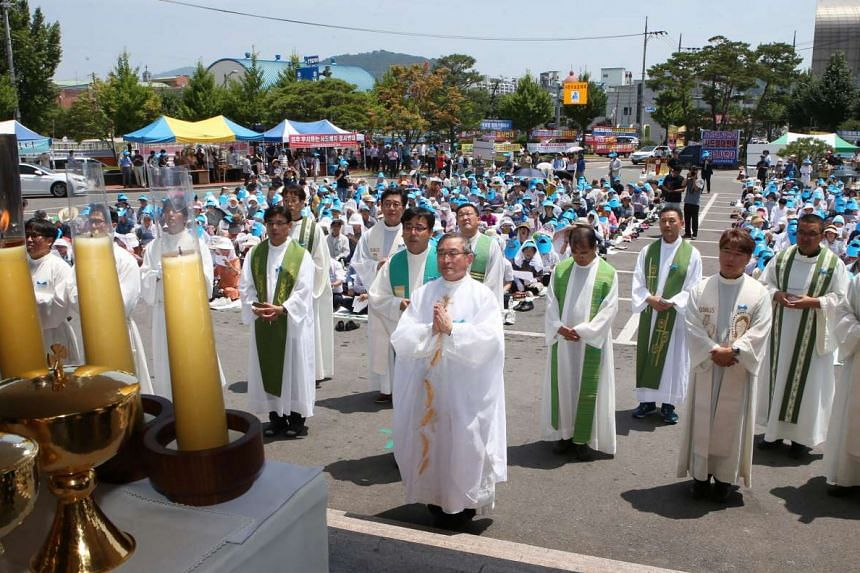 A group of priests stages a protest against the deployment of the Terminal High-Altitude Area Defense (THAAD) system in Seongju on July 23, 2016.