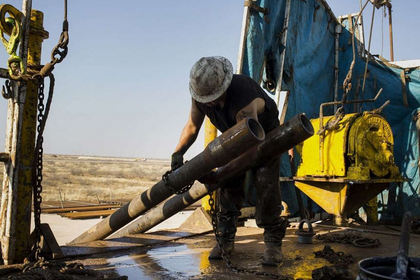 A plunge in oil prices sparked construction layoffs in Saudi Arabia, stranding thousands of jobless Indians, Filipinos and Pakistanis.