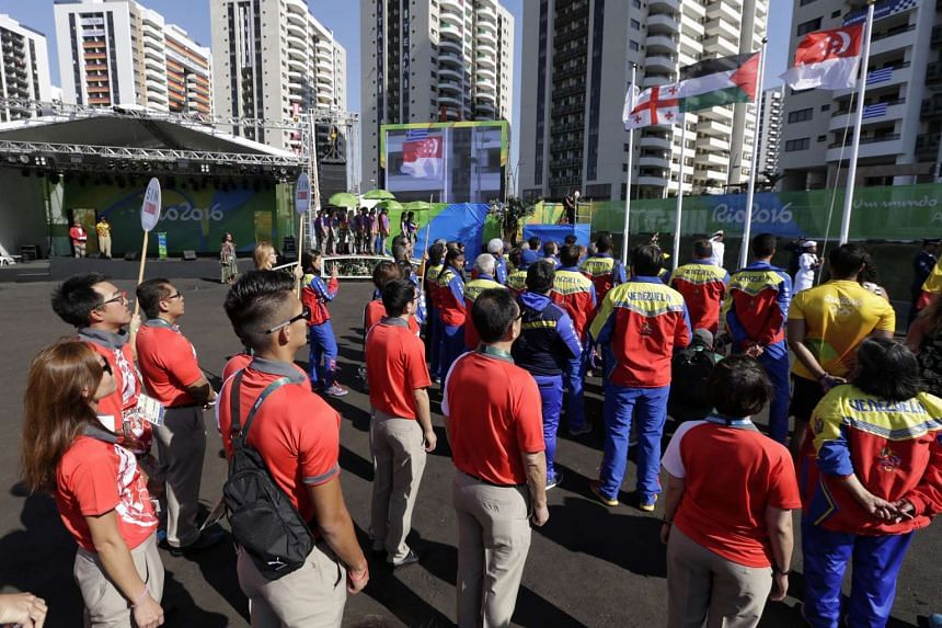 Athletes from from the Singapore delegation attending the flag-raising ceremony during the welcome ceremony at the Olympic Village in Rio de Janiero, Brazil, on Aug 2, 2016.