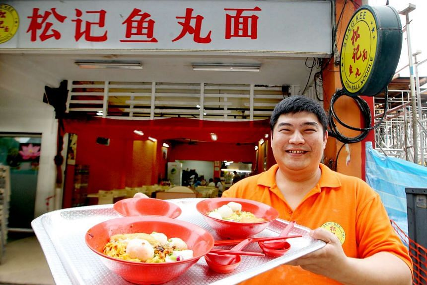 Mr Chua Poh Seng with bowls of fishball noodles at Song Kee Fishball Noodles in 2013.