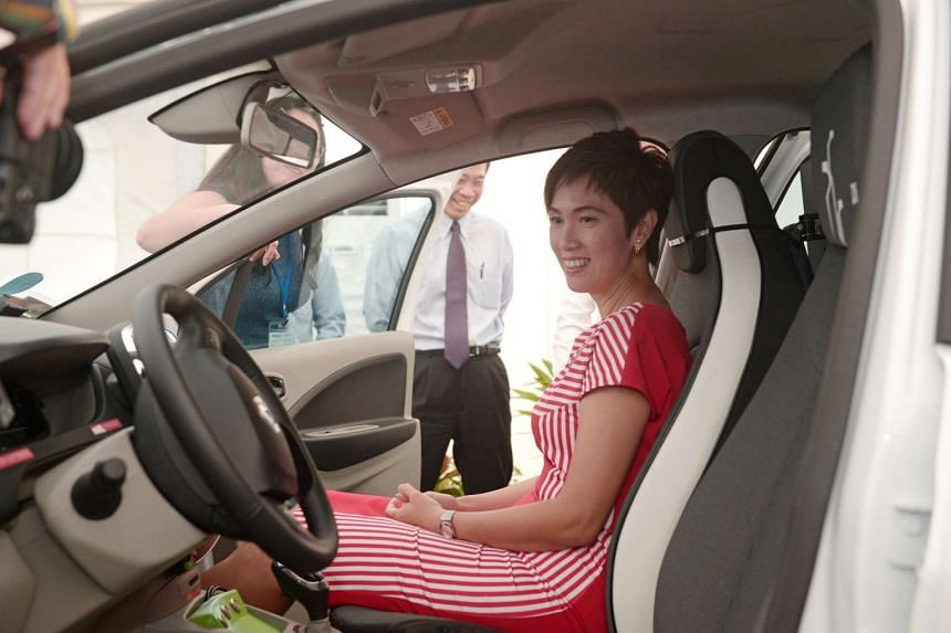 Senior Minister of State for Transport Josephine Teo sitting in an Autonomous Vehicle, a modified Renault Zoe by nuTonomy.