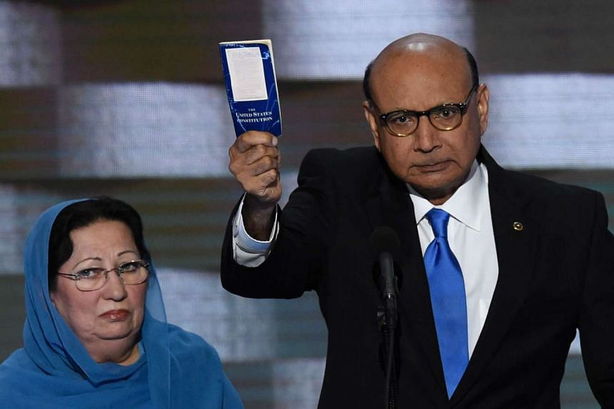 Khizr Khan holding his personal copy of the US Constitution while addressing delegates on July 28, 2016.