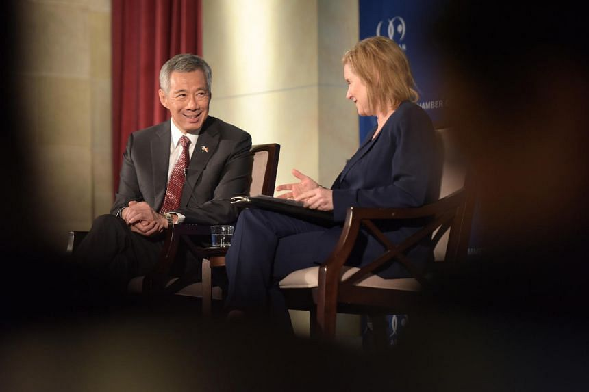 Singapore PM Lee Hsien Loong at US Chamber of Commerce Hall of Flags in Washington, DC, on Aug 1, where he addressed invited guests and also responded to questions at a forum moderated by Ambassador Susan Schwab (right).