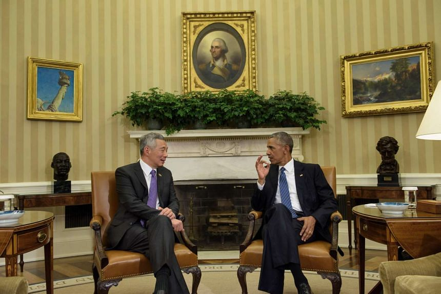 Singapore Prime Minister Lee Hsien Loong (left) and US President Barack Obama speak before a meeting in the Oval Office of the White House on August 2, 2016.