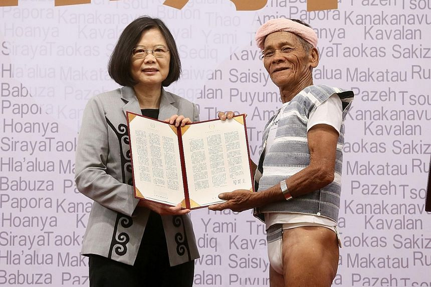 President Tsai with Yami leader Capen Nganaen at yesterday's ceremony, where she formally apologised to Taiwan's indigenous people for their centuries of suffering.
