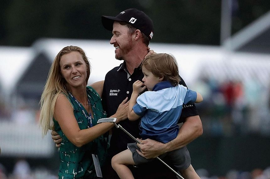Walker celebrating with his wife Erin and son Beckett after winning the 2016 US PGA Championship on Sunday.