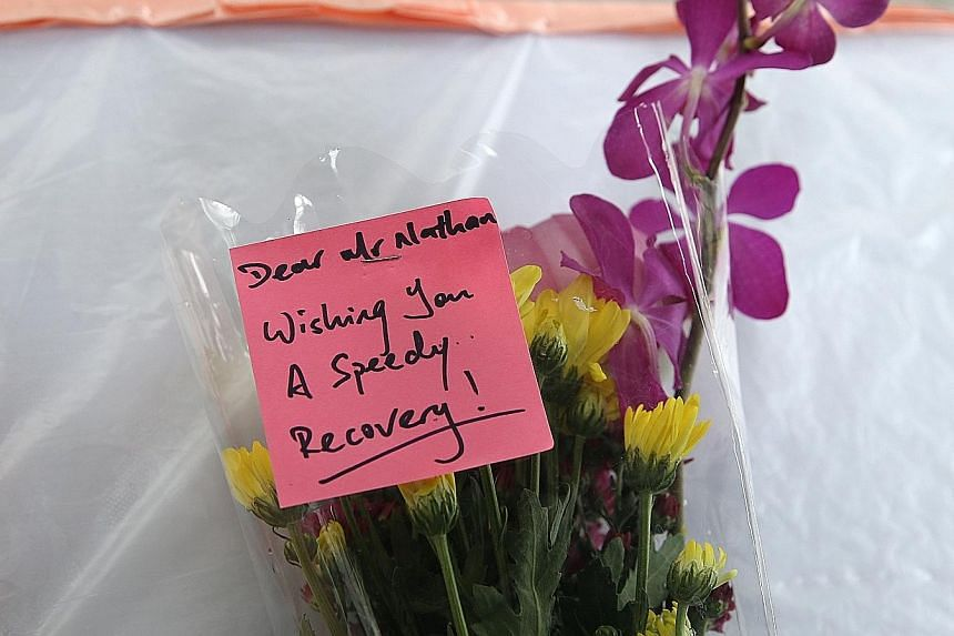 Visitors left flowers for Mr Nathan on a table outside SGH Block 5. He was hospitalised after a stroke on Sunday.