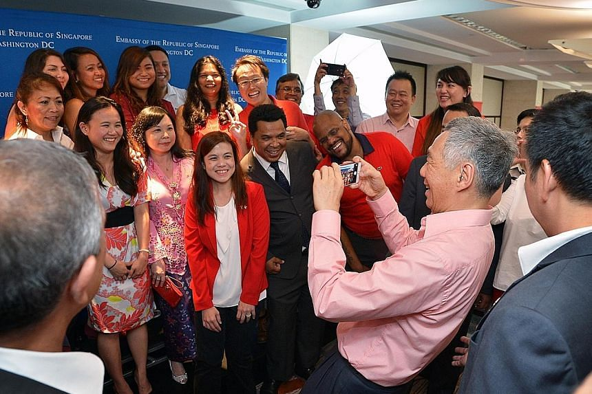 PM Lee and some members of the Singapore delegation are staying at Blair House, the guest house of the US President. PM Lee taking a picture of the Singapore Embassy staff in Washington, DC on Sunday. At the event, he spoke to Singaporeans and took p