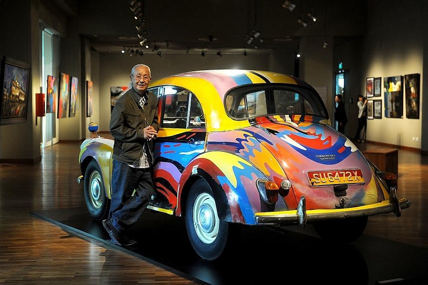 Chieu Shuey Fook with a 1961 Morris Minor which he was commissioned to paint for a charity auction. It is one of the exhibits at Art And Alchemy.