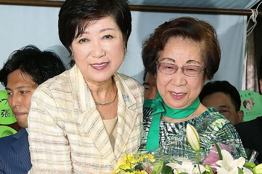 Ms Koike (left), seen here celebrating her win as Tokyo governor in Sunday's election, was deemed a maverick by the LDP's top brass, who threatened to expel her for running without their support.