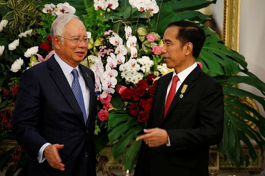 Prime Minister Najib with President Joko after a bilateral meeting at the Presidential Palace yesterday. Both sides also signed an agreement to boost cooperation to campaign against anti-palm oil lobby groups.